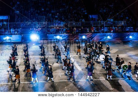 MOSCOW RUSSIA - AUGUST 26 2016: Spasskaya Tower international military music festival. The Celtic Massed Pipes and Drums at the Red Square