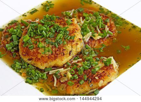 Kaspressknödel, a dumpling-speciality from tyrol in austria, served in beef bouillon