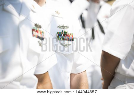 NEW YORK MAY 27 2016: Close up details of the uniform worn by US Navy personnel during the re-enlistment and promotion ceremony at the National September 11 Memorial site during Fleet Week 2016.