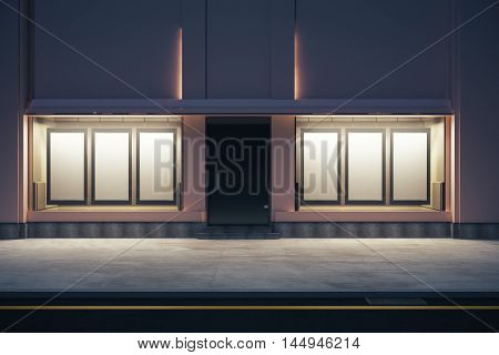 Front view of storefront with numerous empty posters at night. Mock up 3D Rendering