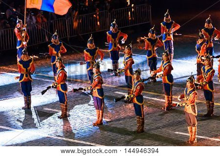 MOSCOW RUSSIA - AUGUST 26 2016: Spasskaya Tower international military music festival. The Mongolian Honor Guard and the Central Military Band of the Armed Forces at the Red Square