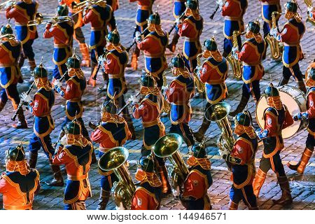MOSCOW RUSSIA - AUGUST 26 2016: Spasskaya Tower internationa military music festival. The Mongolia Honor Guard and the Central Military Band of the Armed Forces at the Red Square