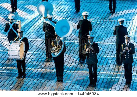 MOSCOW RUSSIA - AUGUST 26 2016: Spasskaya Tower international military music festival. The Central Russian Band of the Navy named after NA Rimsky-Korsakov at the Red Square