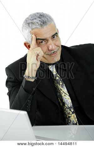 Mature businessman thinking leaning on hand, looking at camera, smiling. Isolated on white.?