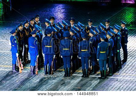 MOSCOW RUSSIA - AUGUST 26 2016: Spasskaya Tower internationa military music festival. The Demonstration band of the Armed Forces and the Honor Guard of the Republic of Belarus at the Red Square