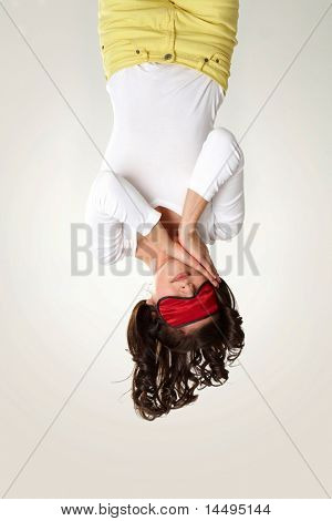 Upside down view of young girl in mask sleeping on white background