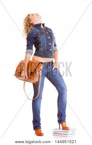 Denim fashion and education. Full length college university student girl with bag books casual woman in stylish blue jeans pants and jacket high heels. Isolated on white background