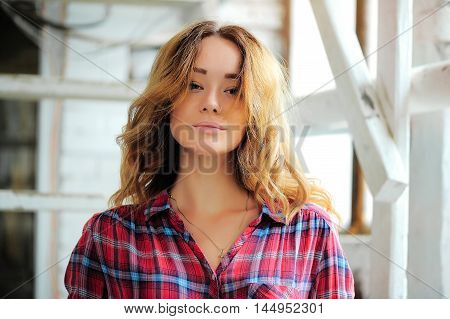 bright girl in a plaid shirt with a nose piercing. Concept of modern youth