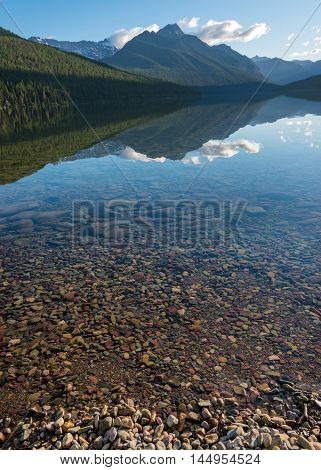Mountain Reflects in the Mid-Morning Light of Bowman Lake in Montana