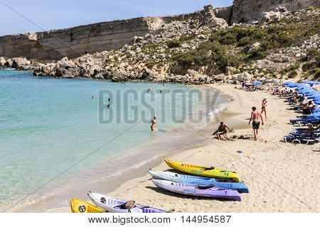 People Enjoy The Clear Beach At Paradise Bay Lido In Valetta