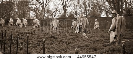 WASHINGTON, DC - DEC 19: Korean War Veterans Memorial in Washington, DC, as seen on December 19, 2015. The memorial consists of 19 stainless steel statues. This is a orange sepia version of the shot.