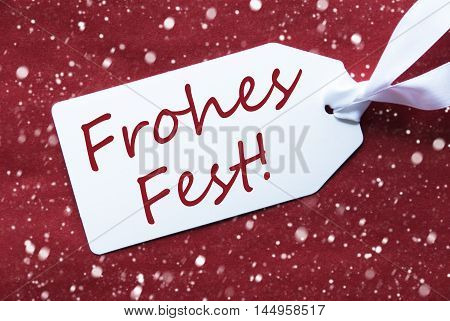 One White Label On A Red Textured Background. Tag With Ribbon And Snowflakes. German Text Frohes Fest Means Merry Christmas