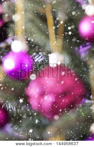 Vertical Blurry Christmas Tree With Rose Quartz Balls And Snowflakes. Close Up Or Macro View. Christmas Card For Seasons Greetings.