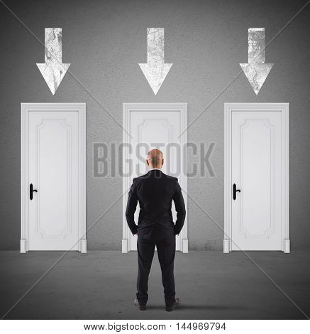 Businessman choosing the right door in which to enter