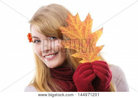 Happy Smiling Girl In Woolen Gloves Holding Autumnal Leaf