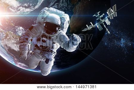 Astronaut in outer space. Spacewalk. Elements of this image furnished by NASA