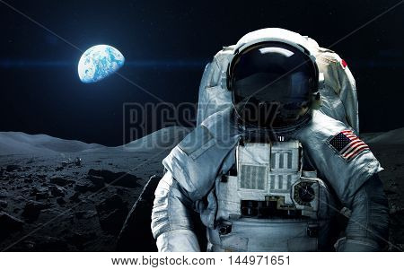 Brave astronaut at the spacewalk on the moon. This image elements furnished by NASA