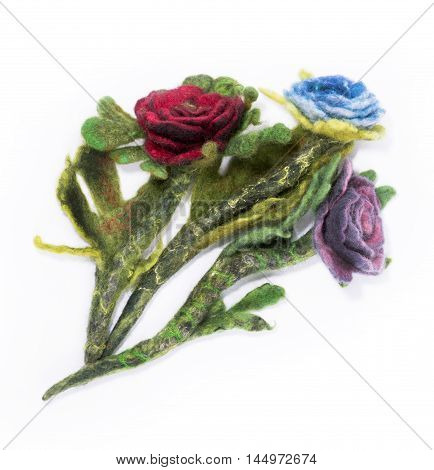 Brooch made of felt wool on a white background in the form of rose flower