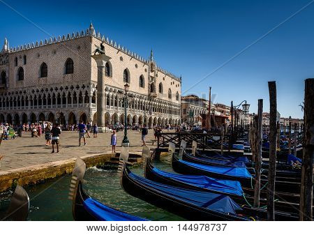 Venice Italy - August 13 2016: Venice Italy. St. Mark's Square and gondolas