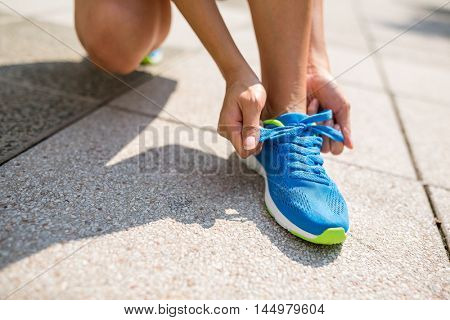 Woman trying shoelace