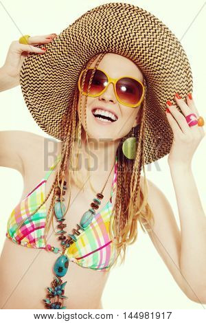 Vintage style shot of young beautiful blond laughing girl with braidy hairstyle, hat and sunglasses