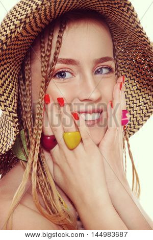 Vintage style shot of young beautiful blond laughing girl with fancy hairstyle, hat and ethnic rings