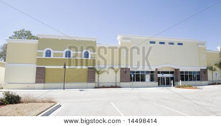 pastel yellow strip mall