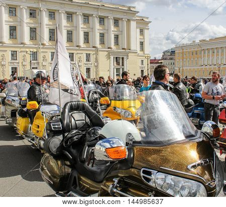 St. Petersburg, Russia - 13 August, People and motorcycles with flags,13 August, 2016. The annual parade of Harley Davidson in the squares and streets of St. Petersburg.