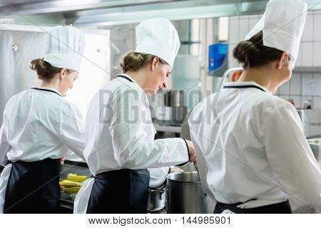Team of female Chefs working in commercial catering kitchen
