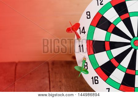 Dart arrow hitting in bullseye on dartboard