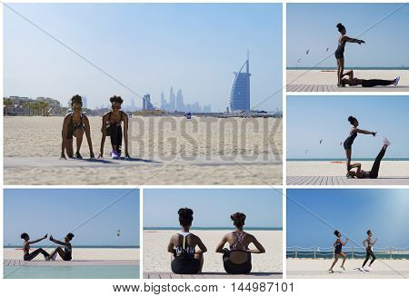 Two african females training together at Dubai beach in the UAE. Outdoor sport activity and healthy lifestyle concept