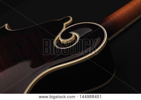 Mandolin isolated on black background detail back side