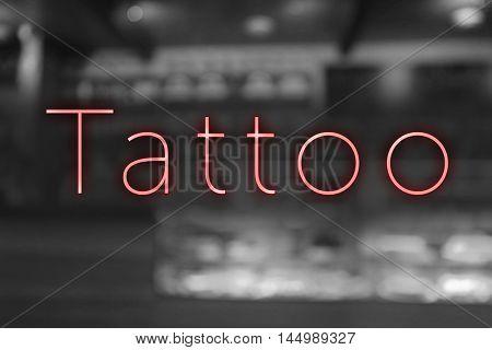 Text Tattoo on blurred background