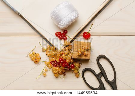 Pile Of White And Red Currants With Scissors, Cherries, Notebook And Scissors