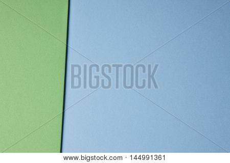 Colored cardboards background in green blue tone. Copy space. Horizontal