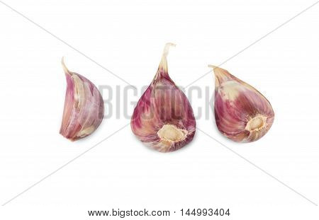 Three garlic cloves isolated on white background. Closeup image of spicy vegetable and herb, healthy natural organic food