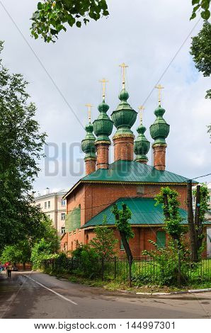 YAROSLAVL RUSSIA - JULY 21 2016: Unidentified people go near Church of Annunciation of Blessed Virgin Mary (built 1688 - 1702 years) Yaroslavl Golden Ring of Russia