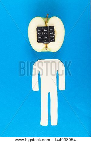 Alphanumeric apple with humanoid body on blue wooden background