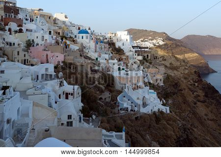 Twinlight view to town of Oia and panorama to Santorini island, Thira, Cyclades, Greece