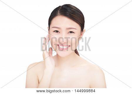 Youthful Vietnamese girl smiling and looking at camera