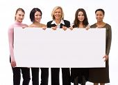 stock photo of covenant  - five businesspeople holding a blank sign inkluding copy space - JPG