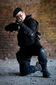 picture of m4  - NATO soldier with M4 rifle on the brick wall background - JPG