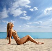 stock photo of monokini  - Sexy lady wearing swimsuit on the beach - JPG