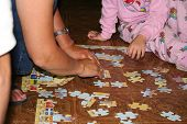 picture of reunited  - My family fixing a puzzle on the kitchen floor - JPG