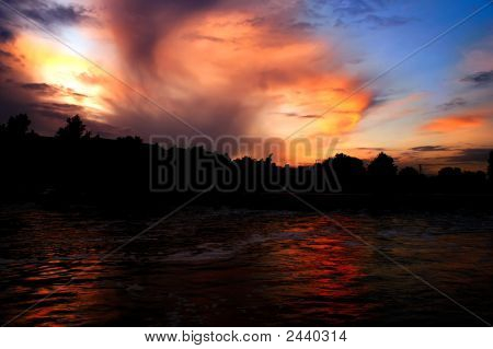 A Sunset Over The Weir On The Warwickshire Avon