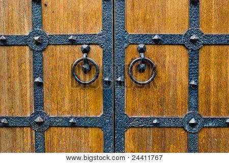 Wooden Door With Metal Door Handle.