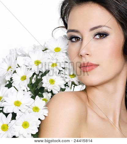 Portrait Of Sexy Woman With White Flowers