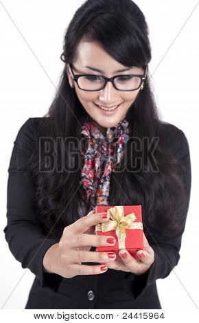 Pretty Asian Businesswoman Opening A Gift