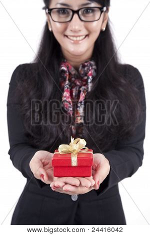 Businesswoman With A Christmas Gift Box On Her Hand