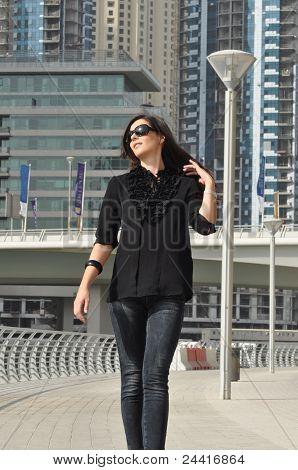 Young Beautiful Woman Walking On Quay